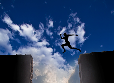 A man leaps from one building to another