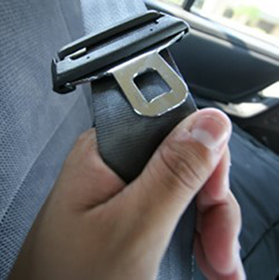 A seatbelt being pulled